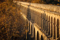 Old roman aquaduct in montpellier sunset photo of Stock Images