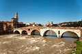 The old roman bridge in verona spans river etsch Royalty Free Stock Photo