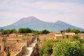 Old roman pompei ruins with mount vesuvio pompeii in the background Stock Photography