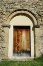 Old romanesque church entrance Stock Image