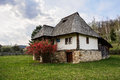 Old romanian peasant house village museum valcea romania made from wood and stone Royalty Free Stock Images