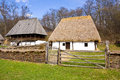 Old romanian rural architecture represented by a couple of ancient rustic houses Stock Photo