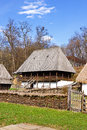 Old romanian rural architecture represented by a couple of ancient rustic houses Stock Photography