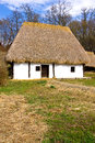 Old romanian rural architecture represented simple hay roof house Stock Photography
