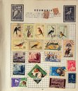Old romanian stamps page from stamp album containing podtage dating from s Stock Photo