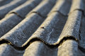 Old roof unhealthy fiber asbestos home Stock Photo