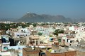 Old roofs of Udaipur with Monsoon Palace,India Stock Photo
