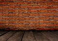 Old room with brick wall vintage background used in advertising design Royalty Free Stock Photo