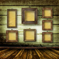 Old room, grunge  interior with frames Stock Photography
