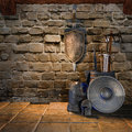 Old room with medieval weapons and armour Stock Photos