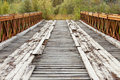 Old rotten abandoned bridge leading to nowhere Royalty Free Stock Image