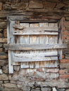 Old rotten hatch in a rustic brick wall wooden hatchin Royalty Free Stock Photo