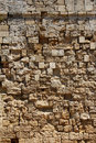 Old rough stone wall background coarse texture Stock Images