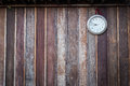Old round clock hang on old wooden wall Royalty Free Stock Photo