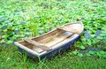 Old rowboat in the lotus field Royalty Free Stock Photo