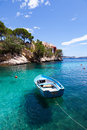Old rowboat moored in cala fornells majorca spain Royalty Free Stock Image