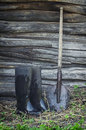 Old rubber boots and shovel Royalty Free Stock Photo