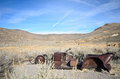Old ruined car in ghost town with blue sky Stock Photography