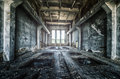 Old ruined factory building from the inside, awesome background Royalty Free Stock Photo