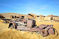 Old ruined metal car in ghost town Royalty Free Stock Photography