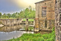 Old ruined mill on the river and scenic sky Royalty Free Stock Images