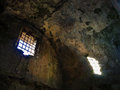 Old ruined prison jail sunlight enters from a window Royalty Free Stock Photo