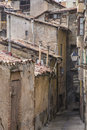 Old ruined street on brick wall homes damaged and houses a narrow an empty urban cityscape Stock Photography