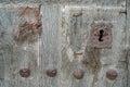 Old run down wooden door and iron lock closeup of vintage rusty Stock Photos