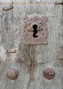 Old run down wooden door and iron lock closeup of vintage rusty Royalty Free Stock Photo