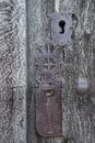 Old run down wooden door and ornamented iron lock closeup of vintage rusty Royalty Free Stock Photography