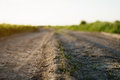 Old rural dust road in sunset light Royalty Free Stock Photo