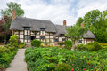 Old rural english cottage view of the beautiful thatched with garden Royalty Free Stock Image