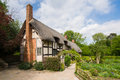 Old rural english cottage view of the beautiful thatched with garden stratford england Stock Photos