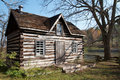 Old rural log cabin with view of river Royalty Free Stock Photo
