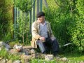 Old rural man resting on a bench Royalty Free Stock Photo