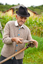 Old rural man using scythe Stock Images
