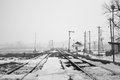 Old rural railroads and railway station in winter time Stock Image