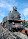 Old russian steam locomotive soviet at the platform Royalty Free Stock Photo