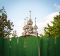 Old Russian wooden church. View over fence. Stock Image
