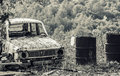 Old and rusted car a graveyard with wrecks in black white Royalty Free Stock Image