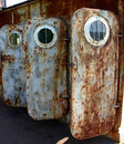 Old  rusted doors with portholes Stock Images