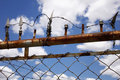 Old rusted electric fence Stock Images