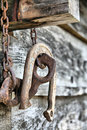 Old Rusted Horseshoe and Log Splitter Royalty Free Stock Photography