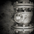 Old rusted industrial valve monochrome closeup photo Stock Images