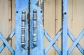 Old rusted lock on blue rusty iron gate Royalty Free Stock Photo