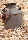 Old Rusted Milk Can in the Woods Royalty Free Stock Photos