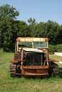 Old rusted tractor in a summer field Royalty Free Stock Photography