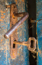 Old rustic door open with rusty lock, key and keyhole Royalty Free Stock Photo
