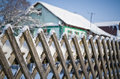 Old rustic fence in the snow. Royalty Free Stock Photo