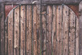 Old rustic and grunge wood texture door close up with bolt Royalty Free Stock Photo